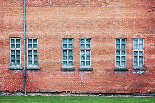 Abandoned architecture background with old weathered brick wall and group of windows