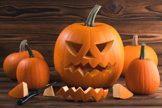 Carving Halloween pumpkin