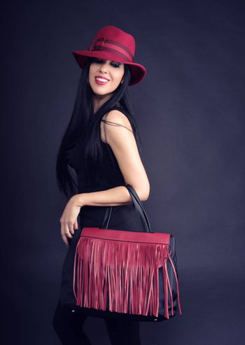 style girl smiling with shopping bags and red hat