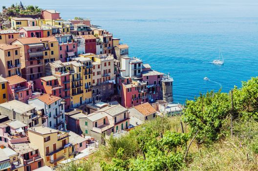 Beautiful summertime view of colorful Manarola town in Cinque Terre, Liguria, Italy