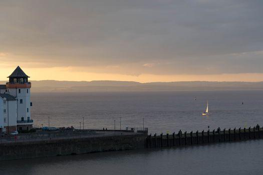 yacht returns at sunset