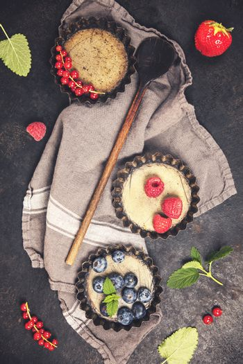 Antique Tartlet tins and ingredients on vintage table. Top view. Rustic background with free text space