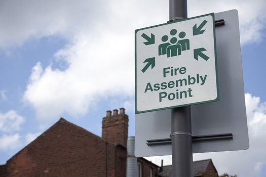 Information sign showing fire assembly point on the street.