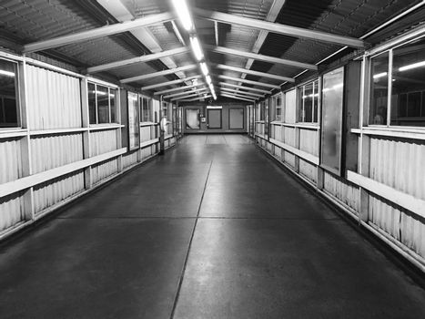 Black and white photography. Footpath on the train station in Hounslow West, London