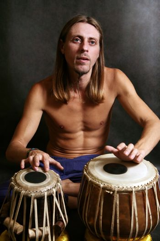 Man playing the nigerian drum in studio