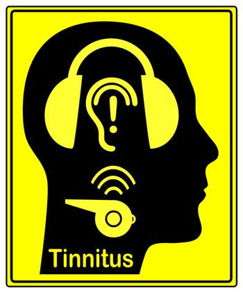 Person wearing hearing protectors to avoid hearing damage like the annoying buzzing and ringing of tinnitus