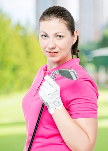 cute brunette has a hobby playing golf, portrait on a background of golf courses