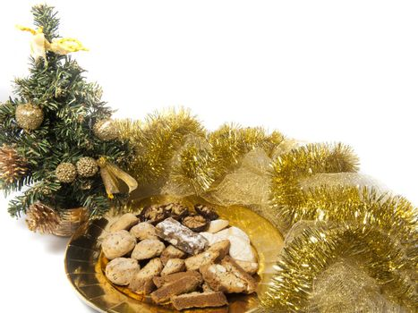 Christmas cookies over a golden plate on a white background