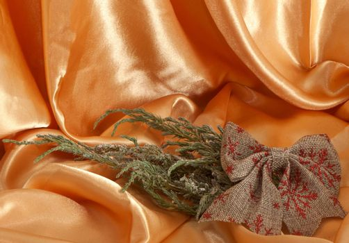 a Christmas decorations on a golden fabric background