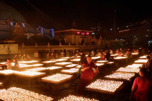 NEPAL. KATHMANDU — MAY 03, 2017 : The offering of burning oil lamps near the stupa  Bouddanath in Kathmandu. Kathmandu is the capital and the largest city of Nepal.