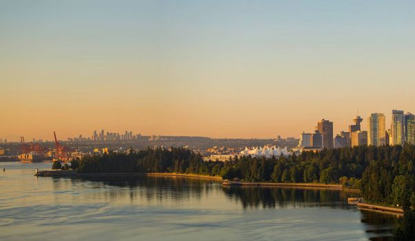 Vancouver British Columbia Canada cityscape by Stanley Park with Burnaby city view during early morning sunrise panorama