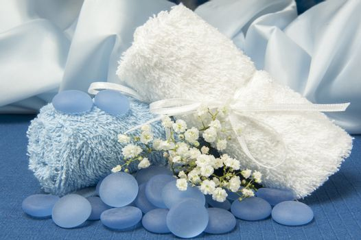 Towels and blue stones on a blue background