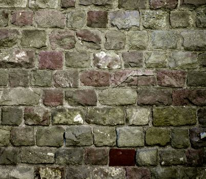 Background of Various Colored Old Damaged Bricks with Concrete Smoothing closeup Outdoors