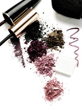 Arrangement of Makeup Brushes, Eyeliner, Mineral Smokey Eyes Shadows and Mascara isolated on White background