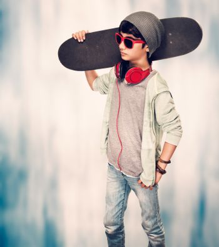 Stylish guy with skateboard
