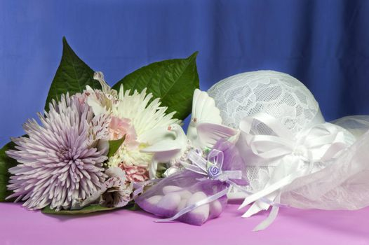 flowers candy and weddings favors on colorfulbackground