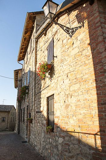 a alley with a old stone housesa