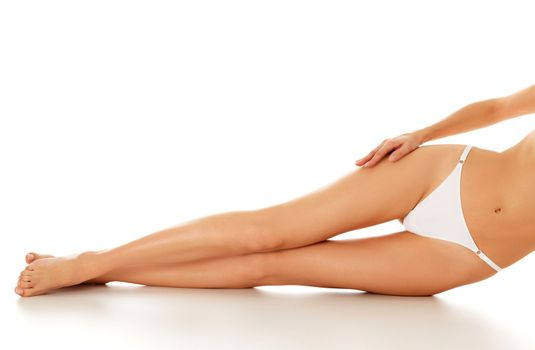 Beautiful long female legs with smooth and soft skin, isolated on white background