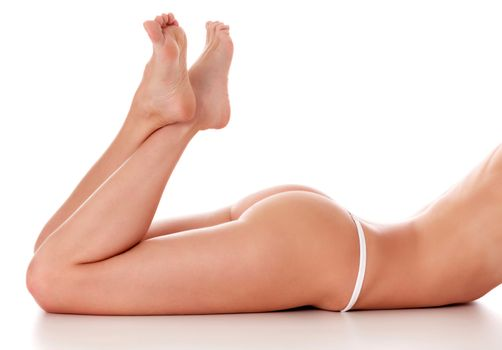 Closeup shot of beautiful female buttocks and legs, isolated on white background