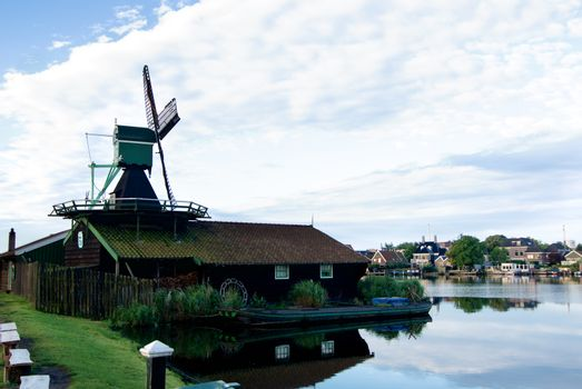 Famous Zaanse Schans Saw Windmill Het Klaverblad with Reflection on Water Early Morning Outdoors
