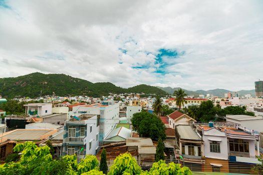 Beautiful view on Nha Trang on blue sky background Vietnam. Nha Trang city panorama with mountains Vietnam