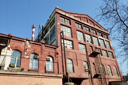 The old industrial building from a brick in the city of Astrakhan