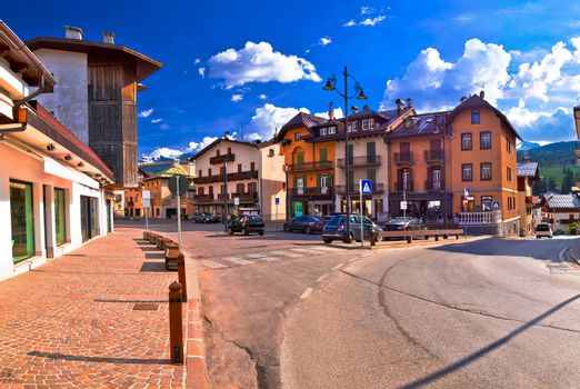 Cortina D' Ampezzo street and Alps peaks panoramic view