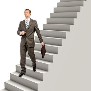 Businessman in formal wear walking down steps