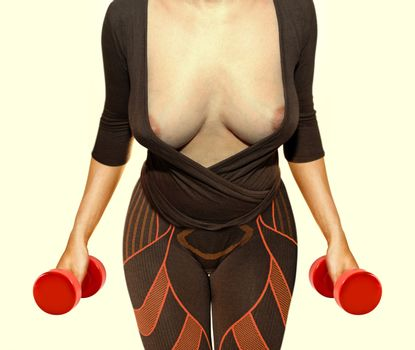 part of body of woman that working out with red dumbbells