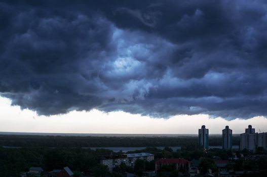 a terrible black cloud is coming to town. dark storm clouds before rain