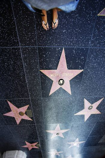 Hollywood, California, United States - September 18, 2011: A person walks along the Hollywood Walk of Fame.
