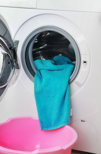 blue terry towel in the washing machine