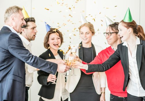 Business people celebrating New Year at office party