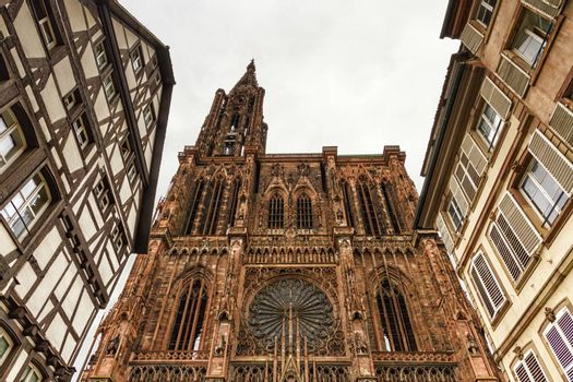 Cathedrale Notre-Dame or Cathedral of Our Lady of Strasbourg behing famous typical half-timbered houses, Alsace, France