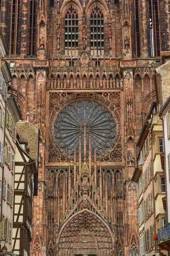Close up on the Cathedrale Notre-Dame or Cathedral of Our Lady of Strasbourg behing famous typical half-timbered houses, Alsace, France