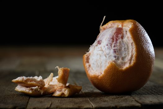 Picked grapefruit on a wooden table, juices and peaches, old kitchen