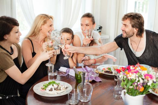 A group of casual friends are having meal in a restaurant.