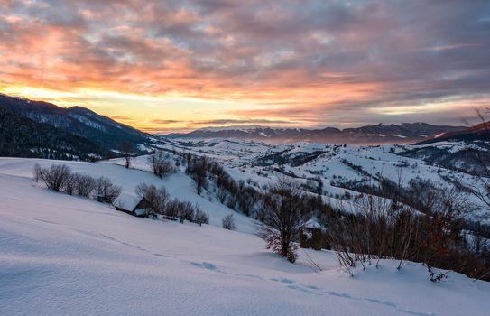 winter dawn in mountainous countryside