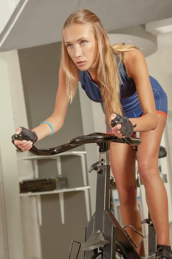 Young Woman Cycling Gym