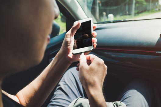Man using phone in the car.