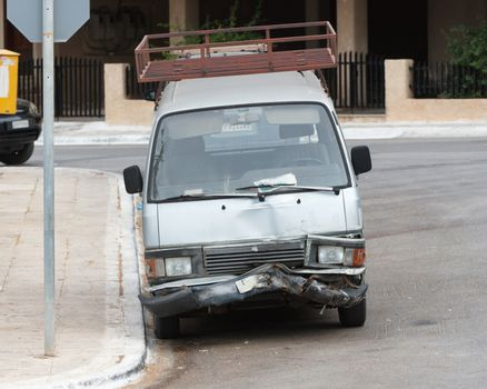 Busted bumper on front end of a modern van