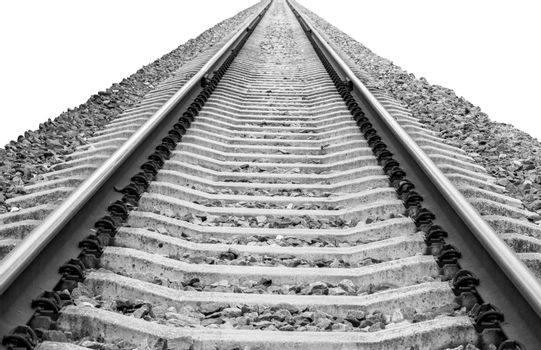 Closeup of railroad track vanishing to horizon, isolated on white background, black and white picture