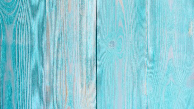 Stain Knot Turquoise and Beige Wooden Background closeup