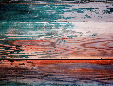 Background of Red, Beige and Dark Green Peeling Old Wooden Board closeup
