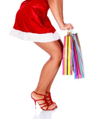 Woman in red dress with colorful shopping bags, isolated on white background