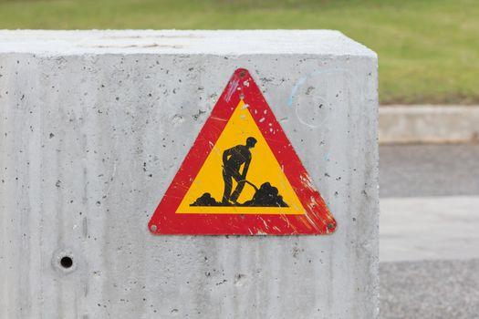 Triangular construction sign