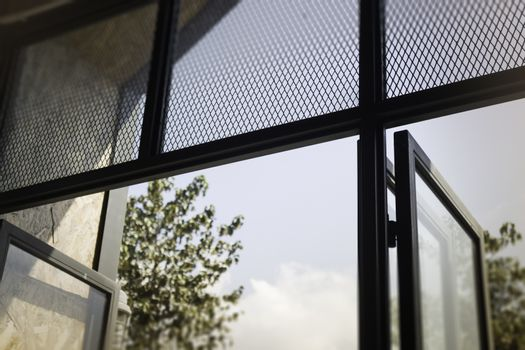 Modern loft window with natural outside view, stock photo
