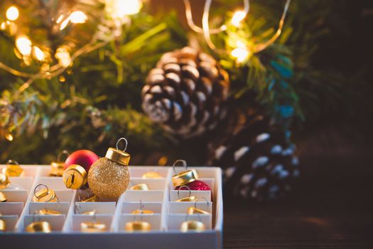 Unpacking Christmas balls toys with glittering garland