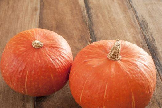 Two fresh whole raw pumpkins
