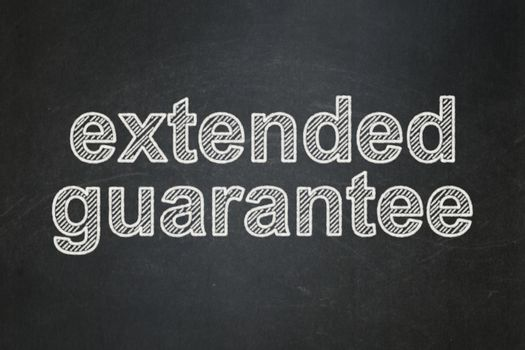 Insurance concept: text Extended Guarantee on Black chalkboard background